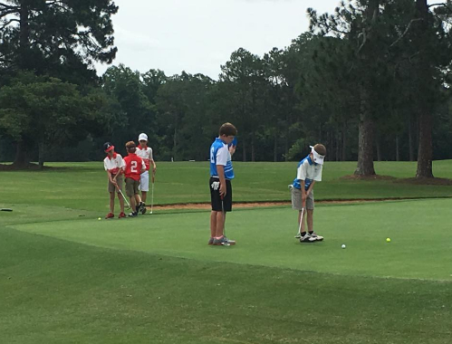 A group of kids practice their short game at Griffin Bell Golf Links